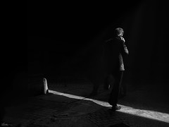 Rigth time - right place (René Mollet) Tags: time place sun shadow streetphotography street streetphotographiebw sunrise people man phone strip penf urban blackandwhite bw renémollet