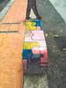 Benchmark (Steve Taylor (Photography)) Tags: bench art digital graffiti streetart seat concrete man asia city singapore lines texture cover stepping walking
