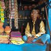 Blue (Dick Verton ( more than 12.000.000 visitors )) Tags: blue shop streetview streetlive varnasi india travel asia streetphotographer man sitting vendor people sit seated
