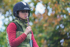 Champion (Frank Fullard) Tags: frankfullard fullard candid street portrait horse jockey horsewoman lady woman colour color ballinasloe red green bokeh galway fair whip doubtful face hat helmet safetyhelmet tree autumn eyecontact eye stare champion