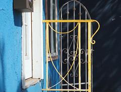 Gates (Grazerin/Dorli Burge) Tags: gate blue yellow wall detail streetphotography picoblvd santamonica california elements color window windowsill