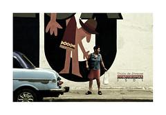 Untitled.   ( La Habana ) 2003 (José Luis Cosme Giral) Tags: untitled woman wall car travel street olympus xa2 lahabana cuba 2003 scanned