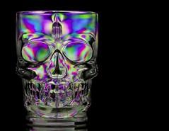 Skull (Karen_Chappell) Tags: crosspolarization black halloween holiday stilllife skull mug plastic product green blue purple multicoloured psychedelic polarized