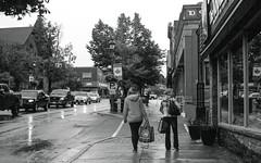 Walking Along Main St (Bill Smith1) Tags: believeinfilm billsmithsphotography hc110b heyfsc huntsville muskoka olympusom2n rolleisuperpan200 zuikomc50f18lens