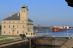 Waiting its turn (GLC 392) Tags: interlake interlakes steamship steam ship company james r barker great lakes freighter soo lock locks poe building office sault ste marie mi michigan boat water river evening light