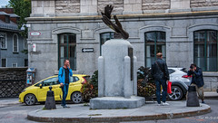 2017 - Quebec City - Feather & Hand (Ted's photos - For Me & You) Tags: 2017 cropped nikon nikond750 nikonfx quebec quebeccity tedmcgrath tedsphotos vignetting canada mariedelincarnation statue sculpture streetscene street people peopleandpaths smoker roundabout ursulines ursuline placedestourangelles hand photographer monument bollards vehicles cans2s