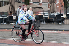 The cyclist (f22photographie) Tags: cyclist cycling panning momentintime freezingaction hairbands docmartens transportation streetscene streetphotography amsterdam coats colourfulcoat stockings jupiter9lens holland thenetherlands