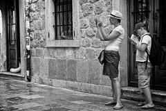 Somebody's Watching (Alfred Grupstra) Tags: people street outdoors blackandwhite urbanscene men women city lifestyles citylife females adult caucasianethnicity males youngadult architecture tourist twopeople kotor montenegro creep