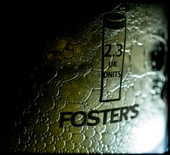 Drink alcohol. (CWhatPhotos) Tags: cwhatphotos froth pint glass closeup drink macro olympus em5 light shadow shadows lager beer booze fosters amber nectar golden pub alcohol pictures picture images image that have which contain photos photo foto fotos bubbly bubbles flickr