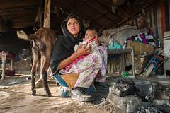 Young mother with her child (Sohail Karmani) Tags: sahiwal montgomery mirrorless leicaq leica pakistan punjab villagelife village summilux 28mm punjabi street streetphotography southasia travel portrait streetportrait