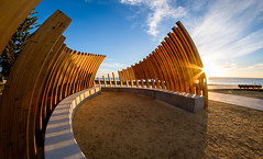 New Light on New Bones (ajecaldwell11) Tags: sand sunrise ankh dawn xe2 fujifilm clouds lights timber marineparade hawkesbay newzealand beach napier 2017 bones sculpture sky park concrete caldwell water light