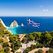 Greek biggest national flag waving in the sky in Keri in Zakynthos Zante island in Greece