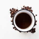 A cup of black coffee and coffee beans thumbnail