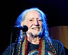 A smile from Willie (Dee Gee fifteen) Tags: flickrfriday timing willienelson concert icon entertainer smile portrait lighting redheadedstranger legend people braids