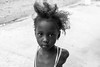 Street Portrait, The Gambia (Geraint Rowland Photography) Tags: bw blancoynegro blackandwhite blackandwhitechildportrait portraits geraintrowlandportraits canon streetportrait thegambia gambianchild banjul eyes face childsface 50mmphotography canontravelphotography wwwgeraintrowlandcouk geraintrowlandphotography westafricantravel westafricans depthoffield focus learnphotography takingportraits 5d2 shooting streets street africa