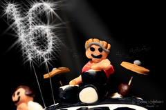 Vamps cake (~ **Barbara ** ~) Tags: macromondays music memberschoice thevamps icing cake small edible paste sugar 61117 macro fun sparklers lit indoors grandaughtersbirthdaycake canon7dii musicalinstruments drums drumkit