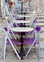 Pavement café (jeremyhughes) Tags: malta valletta city urban pavement stairs cafe tables chairs table chair symmetry symmetrical composition dof 50mm purple colour color nikon d750 500mmf14d nikkor outdoor geometric shapes café