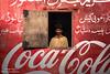 Coke Vendor (Awais Yaqub) Tags: cocacola portrait red advertisment gadani pakistan manposingwithcokeadvertisment southasianman portraitofasianman cocacolaadvertismentinpakistan tuckshop shopkeeper