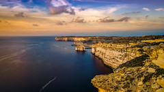 Sunset at the sea (K.H.Reichert) Tags: rocks wardijapunictemple sonnenuntergang wasser ocean sunset meer cliffs twilight himmel sky felsen sea coast wolken clouds sanlawrenz malta mt