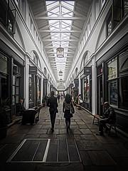 Strolling (Steve Taylor (Photography)) Tags: coventgarden bench art architecture digital stone people uk gb england greatbritain unitedkingdom london texture perspective market arcade slab
