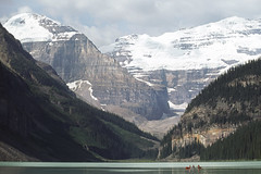 921-89 (George Hamlin) Tags: canada alberta lake louise chateau mountains water people canoe glacier snow green clouds wilderness recreation photo decor george hamlin photography capped peak