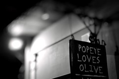 Day 270 : Is for ... The Declaration  Of  Love (Storyteller.....) Tags: 365 deep365 nikon nikon365 blackandwhite blackwhite sign olive popeye love declaration proof statement night message hanging athens city street