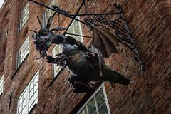 Dragon mum with baby dragon (Journeyman of Words) Tags: animals architecture autumn closeup craftsandtraditions deutschland lübeck urlaub germany schleswigholstein hanseaticcity hansestadt dragon sign drachen schild