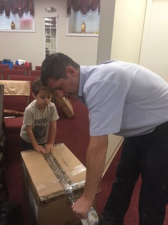 Randy LeBlanc and his son preparing a box to be loaded.