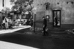 Reflecting on Dog Walking (keycmndr) Tags: blackandwhite dogs newmexico people santafe streetphotography