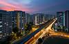 Crossroads (hak87) Tags: singapore punggol hdb flats roads junction car vehicle light trails lrt track sunset