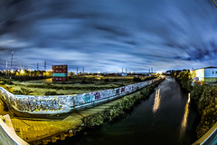 Apocalyptic wasteland (Paul Wrights Reserved) Tags: london edmonton clouds skyscape river canal wasteland graffiti lights starburst landscape