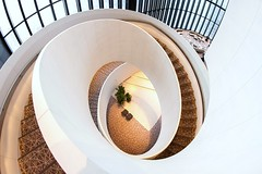 Spiral Staircase (Karen_Chappell) Tags: travel hotel japan osaka stairs staircase spiral circle abstract architecture building interior fisheye canonef815mmf4lfisheyeusm wideangle white lobby steps windows curve lines shape geometry geometric