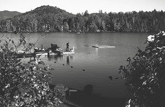Lake Placid (Marcela McGreal) Tags: newyork lakeplacid adirondacks mirrorlake lake fishing fisherman raw blackandwhite blackwhite bw blancoynegro blanconegro bn byn blanco negro black white noiretblanc noirblanc noir blanc biancoenero bianco nero bianconero pretobranco pretoebranco preto branco schwarzundweis schwarz weis nikond3300 nikon