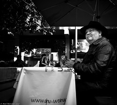 A beer or two (Neil. Moralee) Tags: neilmoralee neilmoraleenikond7200 man beer drinking sitting street care bae pub lager alcohol leather coat jacket german moustache cigar smoke smoker drinker candid table cloth weingarten happy smile old mature glas glasses two black white mono monochrome neil moralee nikon d7200 blackandwhite bw bandw bock pilsner bitter ale booze brew