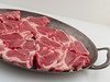 Raw lamb chops. (annick vanderschelden) Tags: lamb sheep cutlet meat thin sliced rib food preparation cuisine cooking raw nutrients fat choppingboard white elasticity gelatine collagene cuts tender tough pig musclefibers connectivetissue water fibers protein structure support bone collagen sturdy juicy temperature molecules bond contraction texture moisture red chops pewter plate belgium