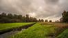het Loetbos bij Lekkerkerk Nederland. (Stevox-1) Tags: polder trees grass clouds water landscape landschap river voigtlander 12mm fuji n net netherlands
