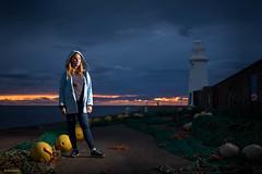 Sunset on the Pier (Silver Machine) Tags: macduff harbour scotland morayfirth lighthouse pier girl sunset fishingnets cactusrf60x cactusv6ii fujifilm fujifilmxt10 fujinonxf35mmf2rwr