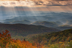 Heavens Rays at Linn Cove Viaduct (Reid Northrup) Tags: sunrise sky rays sunrays landscape forest trees mountains blueridgeparkway blueridgemountains linncoveviaduct viaduct nikon reidnorthrup rrs nature clouds heaven autumn fall fallcolors hills