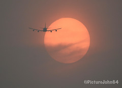 Air Bridge Cargo Boeing 747 (VQ-BHE) crossing an orange colored sun at sunset (PictureJohn64) Tags: flevoland zonsondergang sunset netherlands almere sigma d7100 nikon picturejohn64 jet jumbo 747 b747 boeing flying vliegen airline airliner flugzeug vliegtuig aircraft airplane plane natuur light licht nature lucht sky zon sonne sun