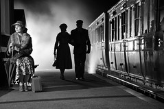 Vintage Mid Suffolk Railway (daveknight1946) Tags: people travel old rail 1940s man lady male female woman station mist steam fog women suitcase sillouite umbrella railcarriage oldrailcarriage