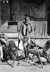 India = man on crutches with begging bowl (rossendale2016) Tags: aluminium tin wooden old injured disabled charity money bowl begging crutches man india