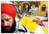 Shyambazar, Kolkata   2017 #17 (b i s w a j i t) Tags: streetphotography kolkata northkolkata animalsonstreet yellow taxi punjabi turban colorful