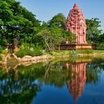 Lake with Stupa and reflection in Muang Boran, Samut Phrakan, Thailand thumbnail
