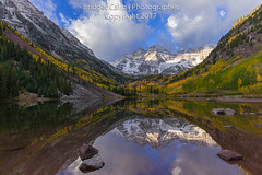 Dramatic Light at Maroon Bells (Bridget Calip - Alluring Images) Tags: 2017 alluringimagescolorado autumn bridgetcalip elkmountains fallcolor maroonbellssnowmasswilderness maroonlake maroonpeak nationalforest northmaroonpeak pitkincounty rockymountains whiterivernationalforest aspentrees blueskies camping dawn deadlybells dramaticclouds fourteenfootpeaks recreation reflection stillwater