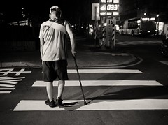 crossing (dr.milker) Tags: crosswalk man cane taiwan taipei youthpark street bw blackandwhite blancoynegro noiretblanc 台灣 台北 青年公園 人 街拍 都市 黑白 urban 斑馬線 人行道 拐杖 sidewalk