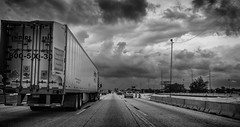 The Grind (tshabazzphotography) Tags: truck tractortrailer road highway city urban interstate4 orlandoflorida blackandwhite bw monochrome thegrind life driving canonphotogrpahy flickr cars depthoffield vanishingpoint sky car automobile classic trucker contrast tones midtones silverefx