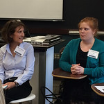 An alumna speaking at a Professional Networking Symposium