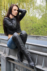 Alexandra 59 (The Booted Cat) Tags: sexy brunette model girl leather jacket thight blue jeans denim overkneeboots overknee boots heels highheels