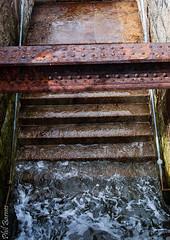 Rising damp (philbarnes4) Tags: iron steel steps stairway sea water folkestone harbour kent england philbarnes down spray splash rust girder wet