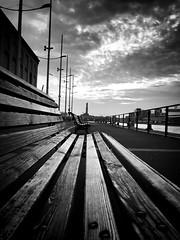 """Sunset In Genova"" (giannipaoloziliani) Tags: flickr photooftheday evening nuvole lantern lanterna benches seaview vistamare vista panchine city italy italia iphone iphonephotography sunlight sun clouds sera view sea tramonto sunset skyline sky genova genoa genoacity porto port portoantico monochrome monocromatico biancoenero blackandwhite"